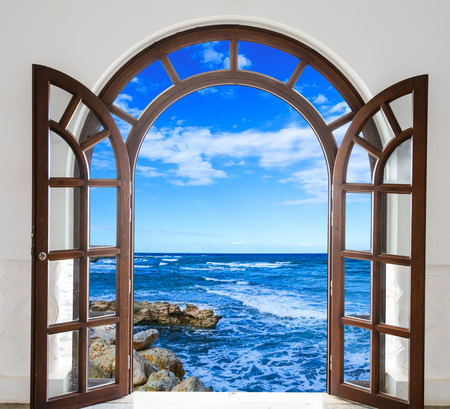 open door arch with sea summer day