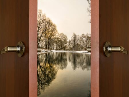 Open the door handle and keys conservatory overlooking the forest and the sun photo