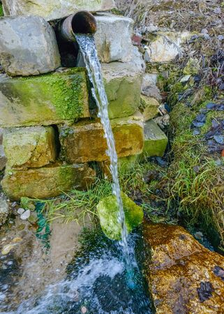 waterfall  dirty: spring with clean drinking water Stock Photo