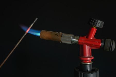 butane: instrument gas burner flame burns blue machine