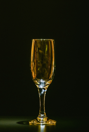 colour in: wine glass with gold color in the dark empty