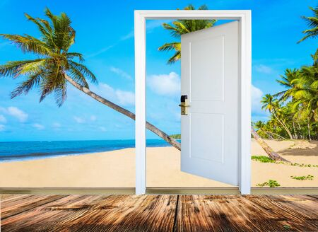 beach access: open door with access to the beach view of palms Stock Photo