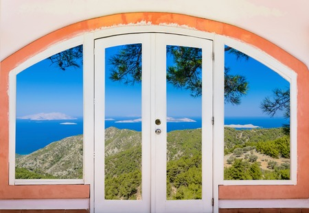 view to outside: nature landscape with a view through a window with curtains