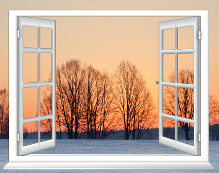 window view: view from the window with the curtains of the sunset over the snow Stock Photo