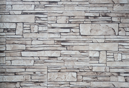 built: abstraction wall fence built of natural stone background