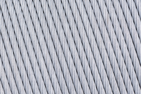 Big Thick Metal Wire Is Wound On The Spool Abstract Background ...