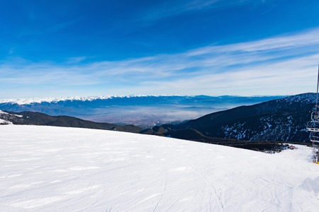 snowcat: top of the ski slopes are prepared trail snowcat