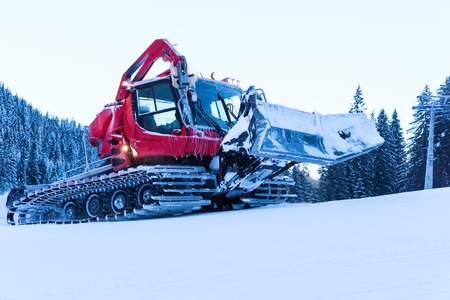 snow grooming machine: snowcat transport preparation ski slope on the hillside