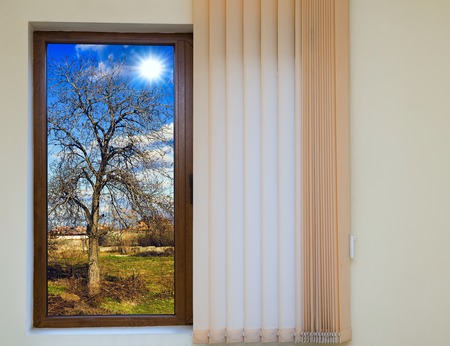 window blinds: wooden window blinds in a house with a beautiful landscape Stock Photo
