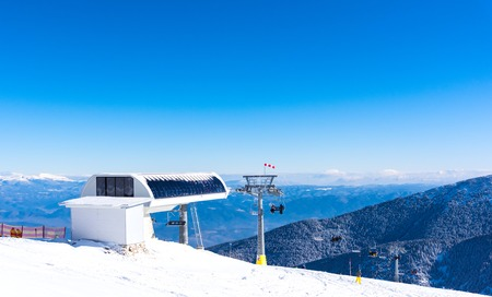 chair on the lift: chair lift for skiing in the mountains in winter