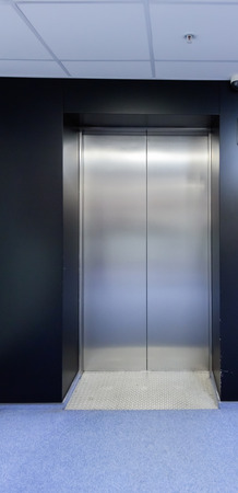 lift gate: Elevator cabin stainless steel in a room on floor
