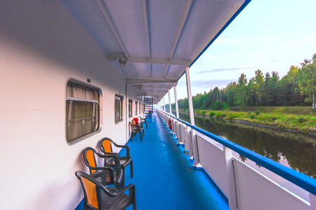 view of the side of a river cruise ship floats on the channel Stock Photo