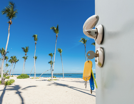 open door with access to the beach view of palms Stock Photo