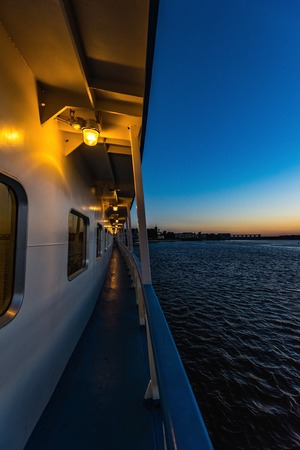 view of the side of a river cruise ship floats on the channel night Stock Photo