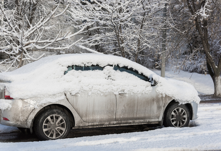 deep freeze: car is parked tunes with a thick layer of snow blizzard cold winter