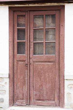 door knob: old wooden door in the wall of the building