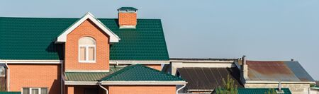 affordable: chimney on the roof of the house against the blue sky