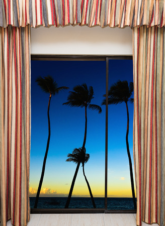 view from the window at dawn tropical sea and palm trees Stock Photo