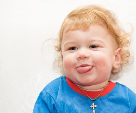 Curly blond child boy with blue eyes portrait