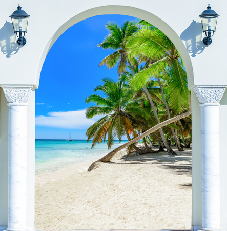 archways: wooden open door arch view of the beach the Caribbean sea Dominican Republic Stock Photo