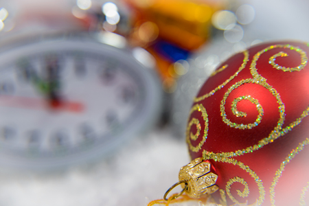 New Year Clock lie in brightly colored shiny tinsel