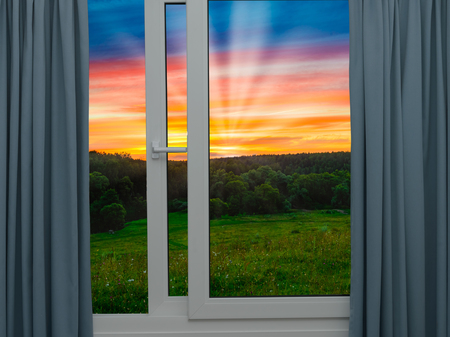 open window view of the sky with clouds sunrise Stock Photo