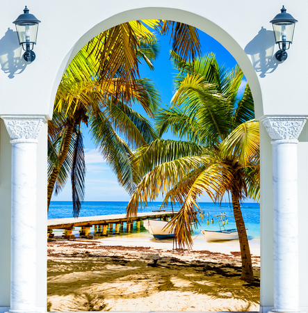 wooden open door arch view of the beach the Caribbean sea Dominican Republic Stock Photo