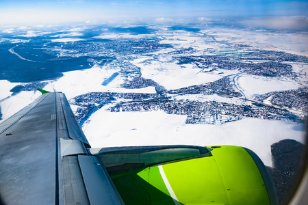 beautiful scenery from the porthole of a passenger aircraft wing with an engine