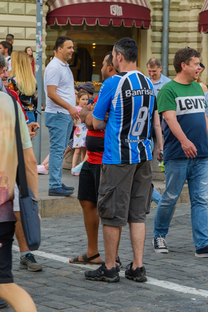 Russia, Moscow-June 2018. 2018 FIFA world Cup. On Nikolskaya street a group of football fans from different countries shouting and gesticulating is photographed