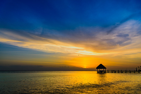 sun sea tropical sunset view of the pier of the Caribbean beach Archivio Fotografico
