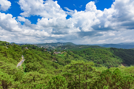 View from the height of tropical green jungle blue sky with clouds, Vietnam Imagens