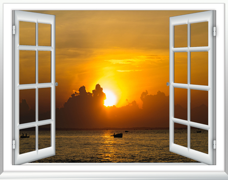 Beautiful sunset on the sea view from the window with curtains open Stockfoto