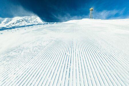 top of the ski slopes are prepared trail snowcat Stock Photo