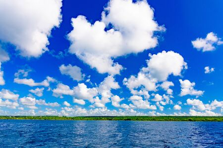 beautiful seascape of the Caribbean sea and sky with clouds