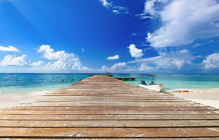 wooden batten bridge juts out into the expanse of the sea Dominican Republic 免版税图像