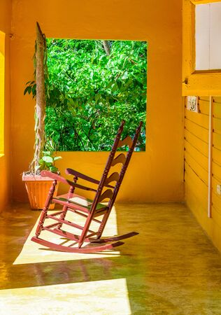 old wooden rocking chair on the balcony of the house 스톡 콘텐츠 - 134527938