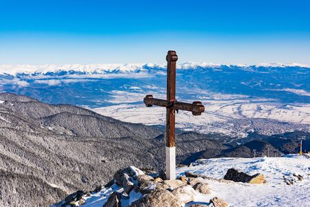 wooden christian cross on top of the mountain commemorative symbol Stock Photo