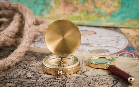 compass and magnifying glass lie on the topographic map Standard-Bild