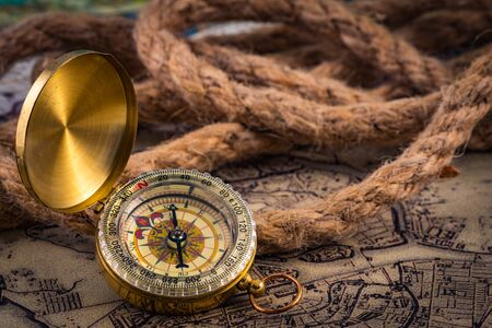 compass lies on an ancient world map