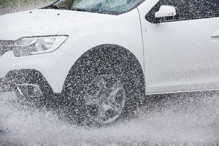 motion car rain big puddle of water spray from the wheels