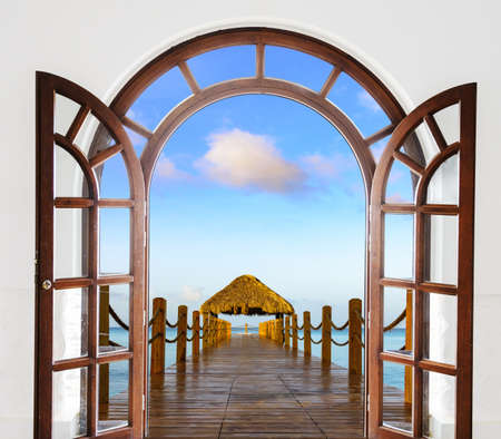 wooden open door arch view of the beach the Caribbean sea Dominican Republic