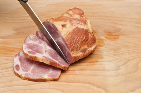 Side view of pork loin slicing on a wooden board Stock Photo - 10801220