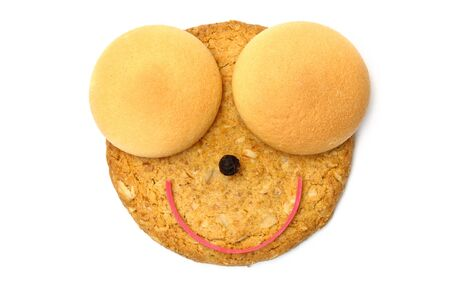 Smiling cookie face isolated on white Stock Photo