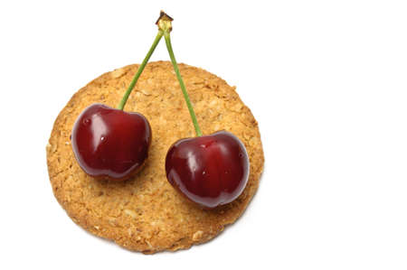 Cherries over a cookie isolated on white Stock Photo - 10801163