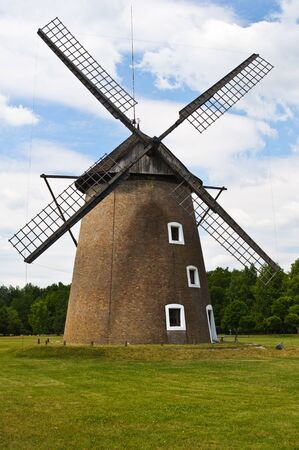 Large windmill on the plains of Opusztaszer in Hungary Stock Photo - 10801231