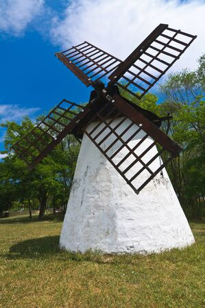 Small, human sized, windmill on the plains of Opusztaszer in Hungary Stock Photo - 10801241