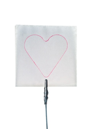 Post-it note with heart shaped drawing isolated on white Stock Photo