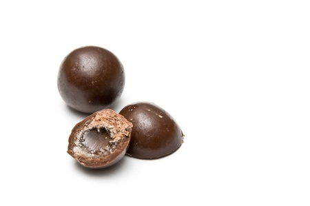 Halved and a whole chocolate ball isolated on white Stock Photo