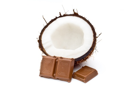 Halved coconut with chocolate blocks isolated on white Stock Photo