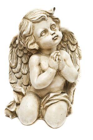 Clay angel praying towards God isolated on white